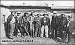 J.J. Bowlen, left, with workers on the Q Ranch