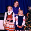 Three young Calgarians show off their colorful Estonian folk costumes during a Christmas Celebration in 1988. L to R: Erika Kivik, Krista Leesment, Milvi Tiislar