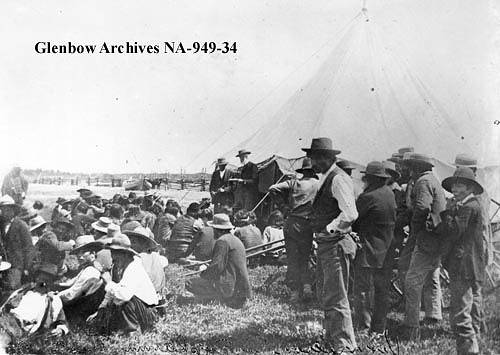Honourable David Laird explaining terms of Treaty #8, Fort Vermilion, Alberta. 1899.