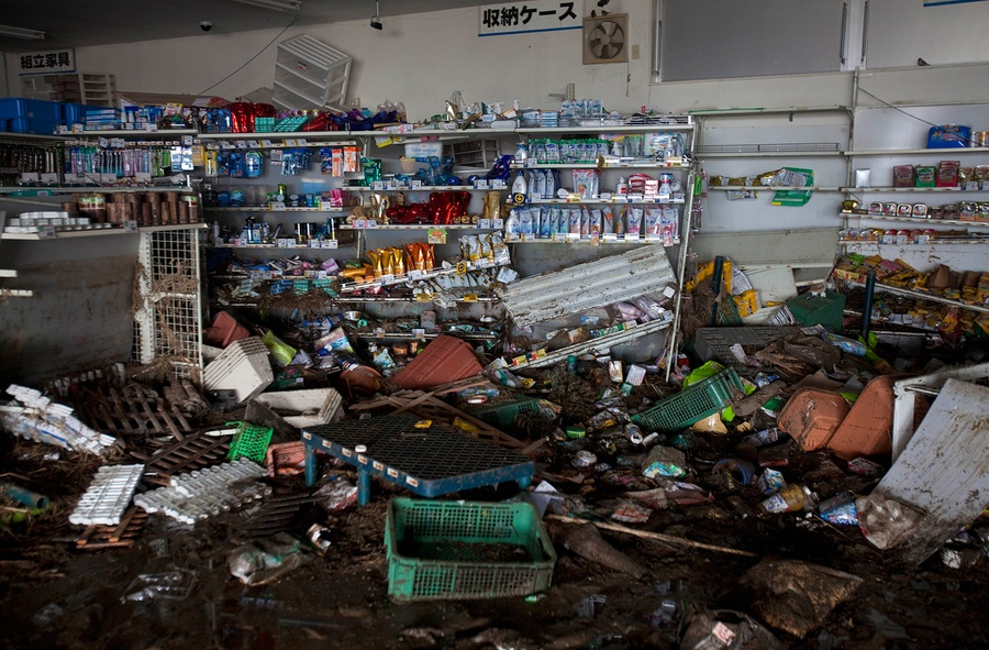 A tsunami-wrecked supermarket is left abandoned in the Odaka area of Minamisoma, inside the deserted evacuation zone established for the 20 kilometer radius around the Fukushima Daiichi nuclear reactors on April 8, 2011