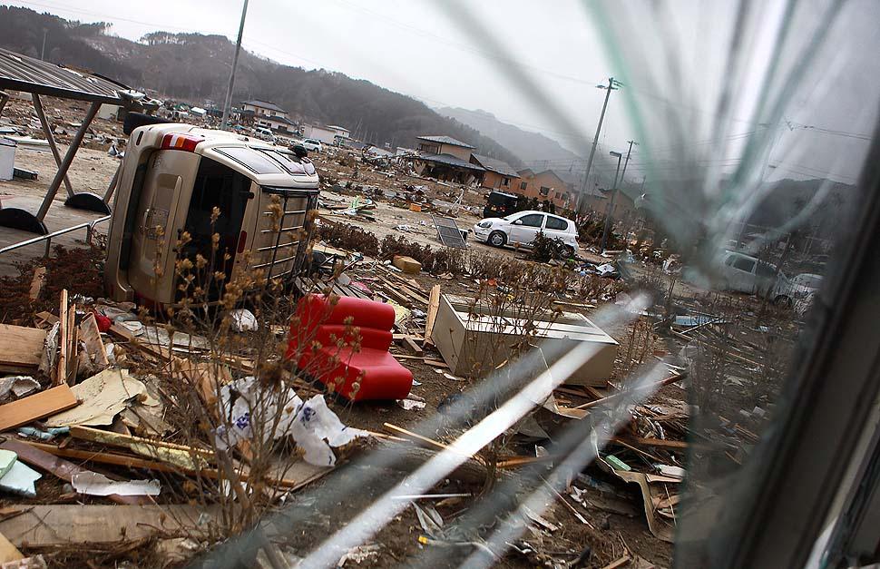 The view through a broken windows at debris outside Yamada Hospital.