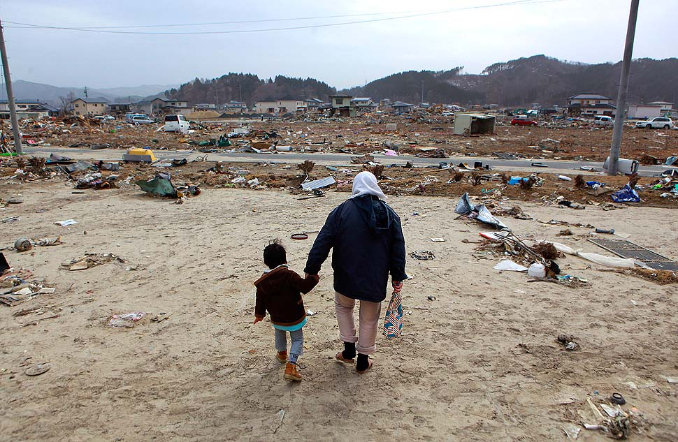 A woman and her son walk through the remains of Yamada, a fishing town destroyed by the earthquake and tsunami.