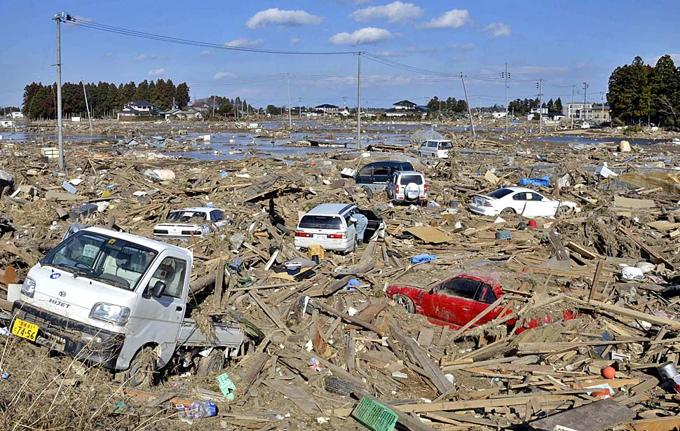 Cars and buildings wrecked by last week's earthquake and tsunami outside Sendai in Miyagi Prefecture