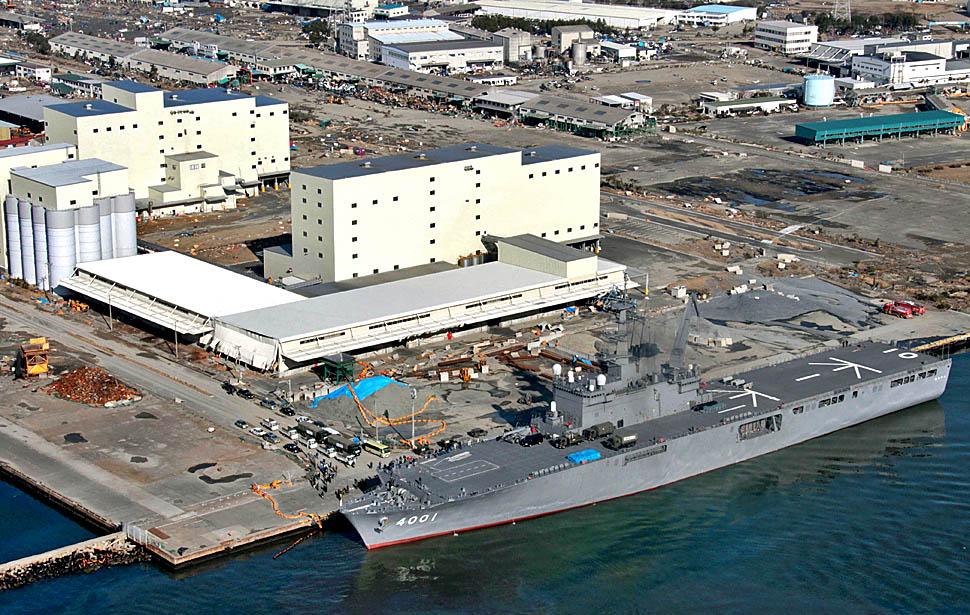 The Osumi, a Japanese tank landing shiip carrying emergency aid, arrives at the port at hard-hit Sendai