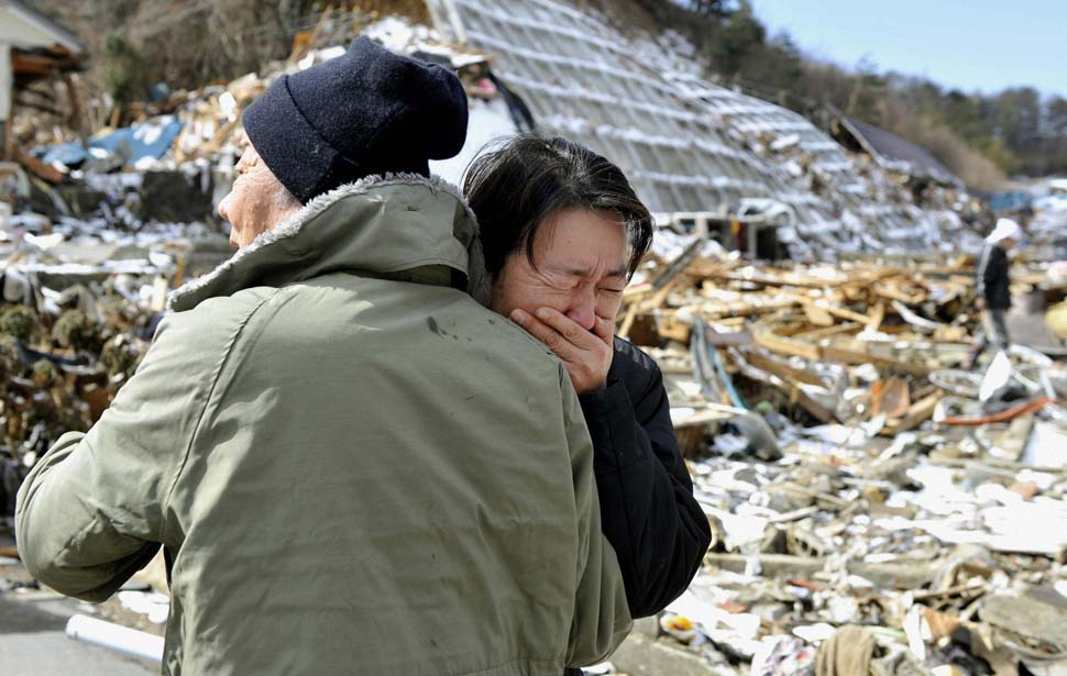 A women cries after her mother's body is found