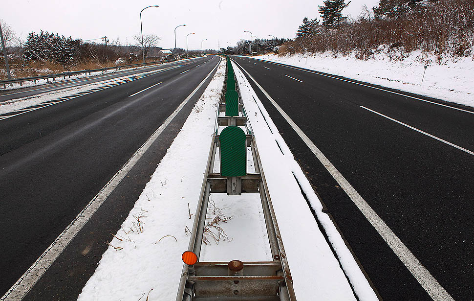 Tho Tohoku Expressway is nearly deserted Thursday as such roads are closed to all but emergency and other essential traffic