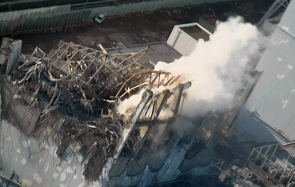 Thick white smoke billows from the No.3 unit of the Fukushima Daiichi nuclear power plant Thursday