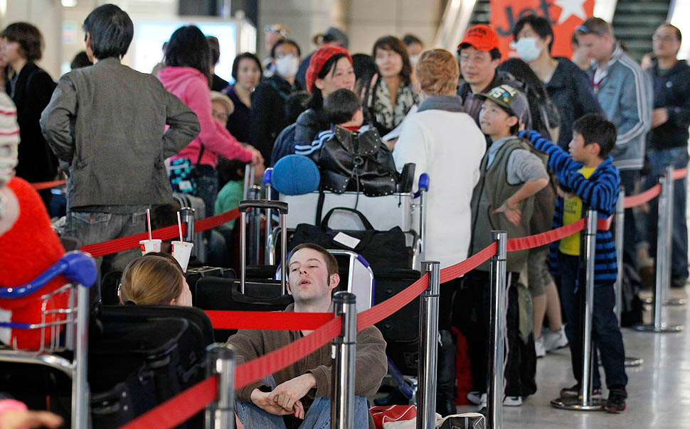 Passengers line up at Narita International Airport on Thursday for a flight bound for Sydney