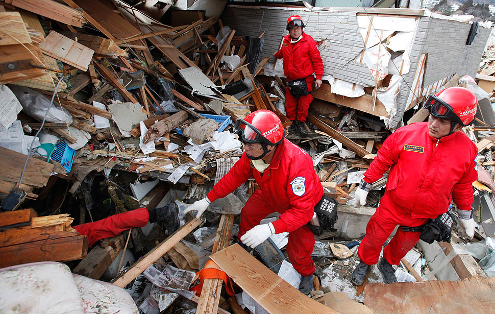 A rescue team from Taiwan searches for survivors