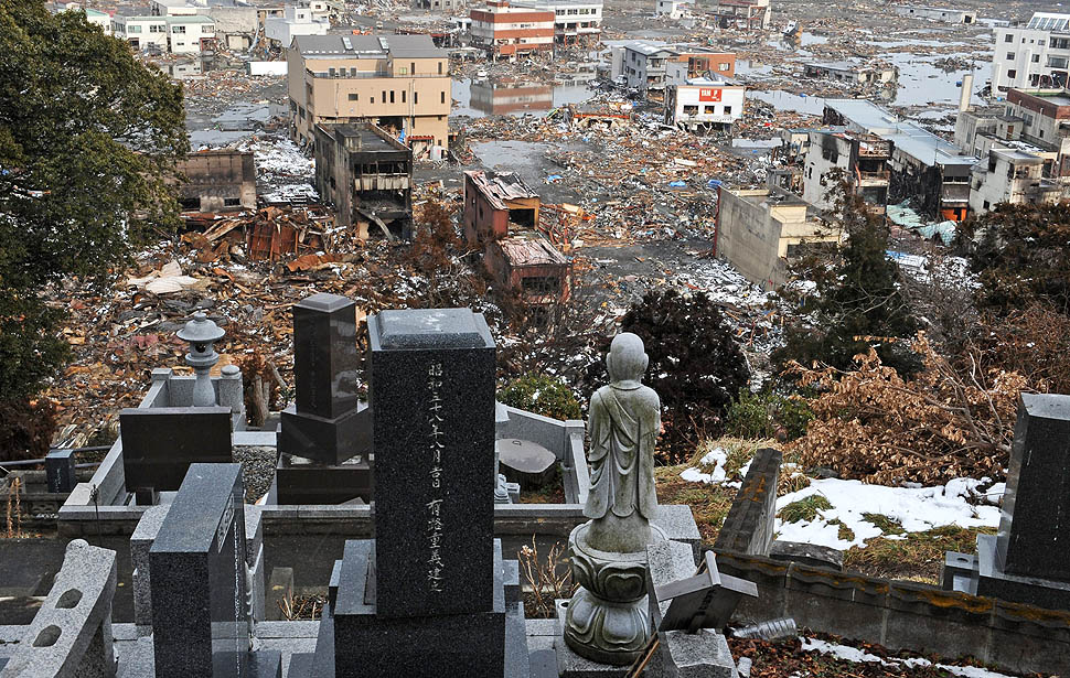 The devastated town can be seen from a cemetary on a hill