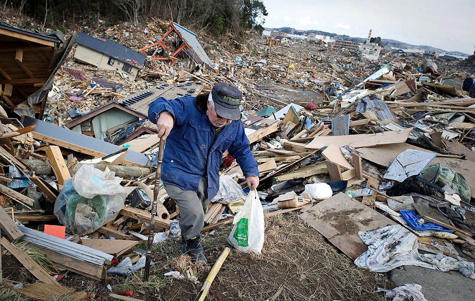 A resident walks through the rubble of homes