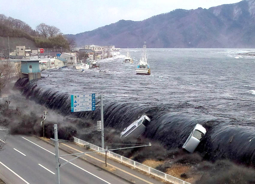 This picture was taken by a Miyako City official on March 11 and shows a tsunami breaching an embankment and flowing into the city of Miyako