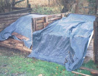 Tarp Covered Compost Bins Photo by Garry Stephenson
