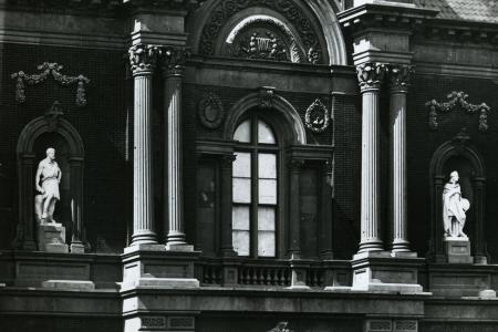 Large marble statues of acclaimed thinkers stand on pedestals on the Renwick's façade.