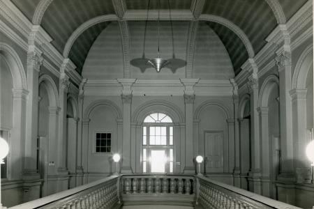 A second floor view of the Corinthian columns and vaulted ceiling at the top of the Renwick's grand staircase.