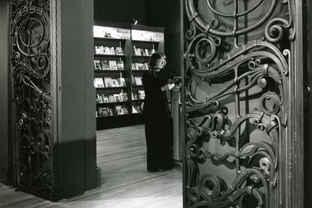 This is a black and white photo of the Paley Gates opening to the museum bookstore.