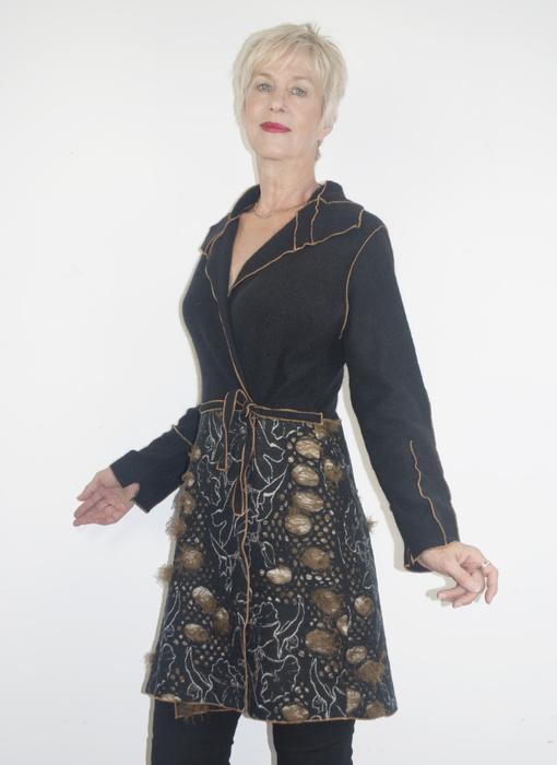 Black top with embellished black A-line skirt
