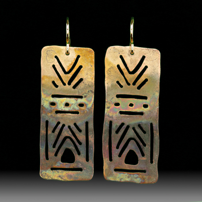 Two copper rectangular earrings with symmetrical cutouts
