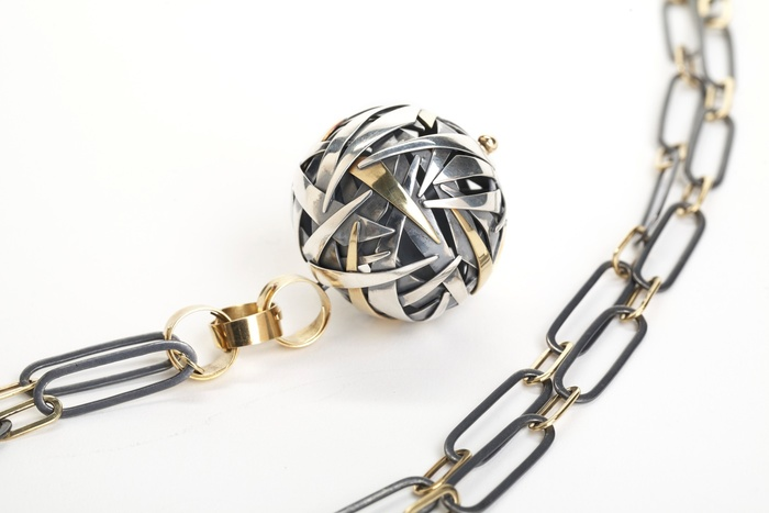 Metal ball on chain