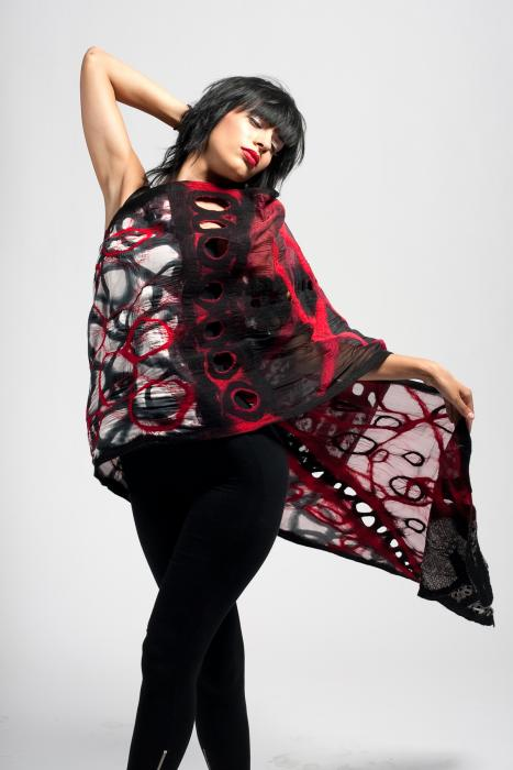 Model wearing felted scarf with organic crisscrossing motif