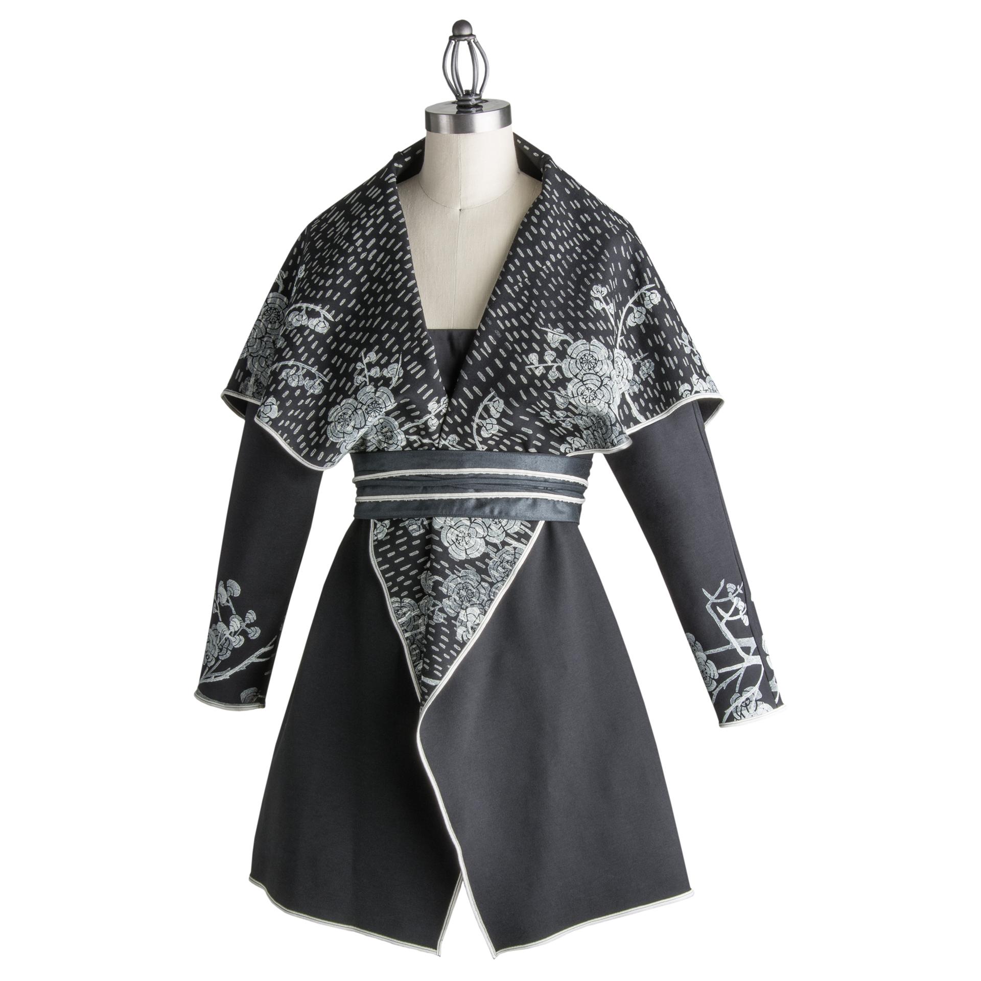 Hand carved linoleum blocks, hand printed on ponte knit fabric. Black jacket.