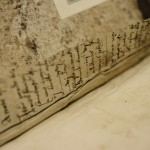 Manuscript waste used as hooked vellum guard in collected histories