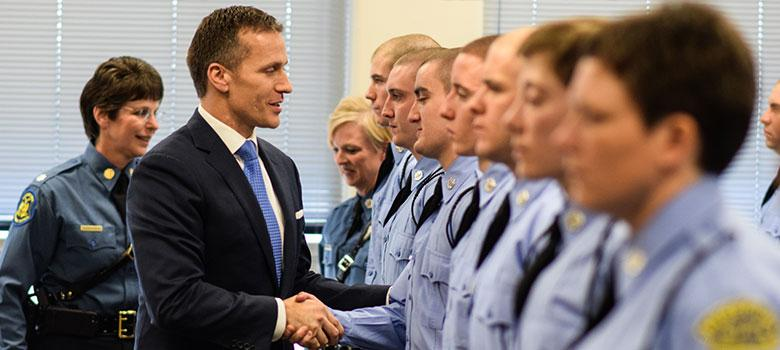 Gov. Eric Greitens shakes hands with recruits