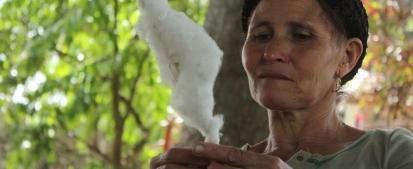 Native healer spinning cotton