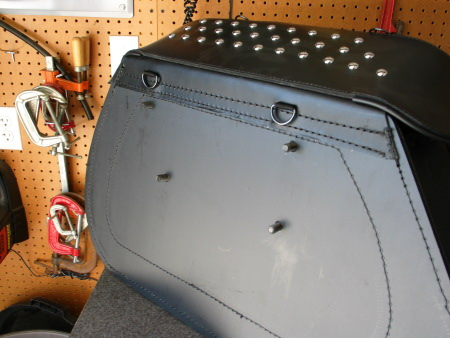 Hurricane bag with bolts pushed through drilled holes