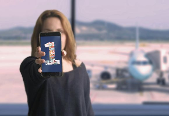 photo a woman holding a phone with the number 1 on it