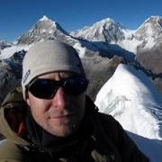 Oliver Wigmore photographed with mountains in background