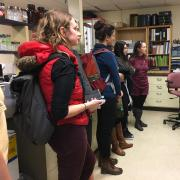USGS scientists explains lab equipment to CU students.