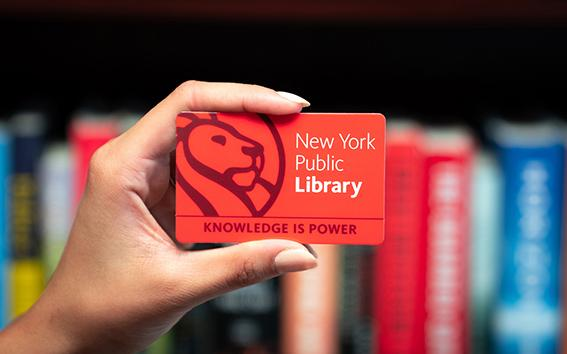 Closeup of someone holding an NYPL library card.