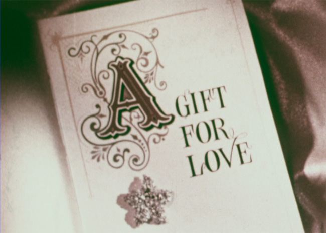 Title still from the film A Gift of Love