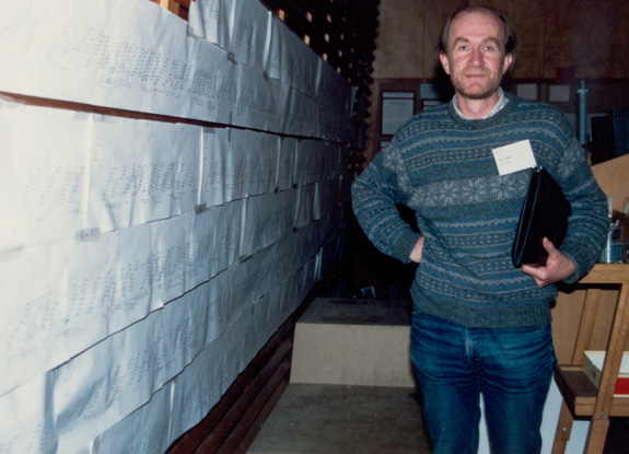Alan Coulson standing beside the physical mapping of the C.elegans nematode. CSHL meeting, May 1989. Image Credit: Barry