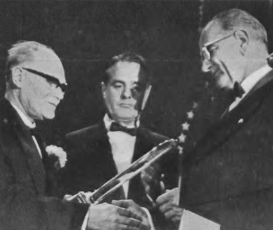 Penrose (right) receiving the award