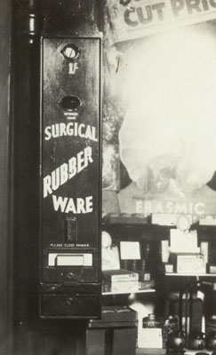 Postcard showing a 'Surgical Rubber Ware' slot machine.Wellcome Images No. V0026285.