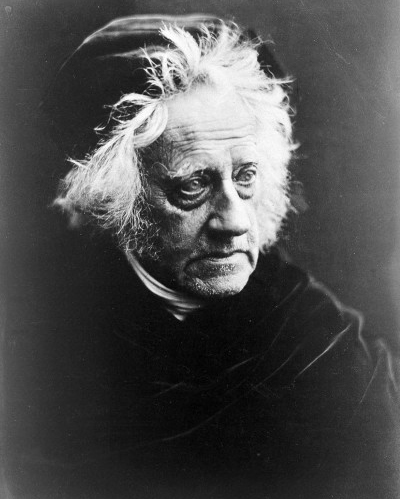 Sir John Frederick William Herschel: wearing a cap and cape. Photograph by Julia Margaret Cameron. Wellcome Library no. 14085i