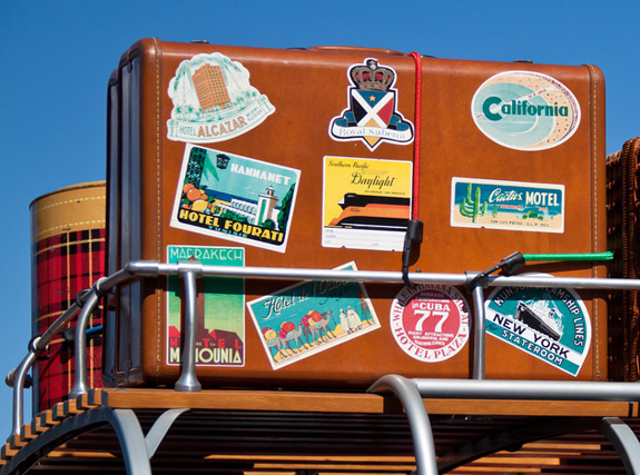 suitcase with travel labels