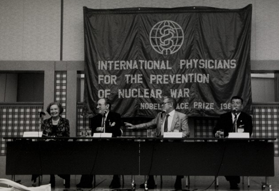 L0075338 International Physicians for the Prevention of Nuclear War Credit: Wellcome Library, London. Wellcome Images Conference panel. International Physicians for the Prevention of Nuclear War.  Medact was formed in 1992 as a merger between the Medical Campaign Against Nuclear Weapons (MCANW) and the Medical Association for the Prevention of War (MAPW). Photograph 1980s Medact
