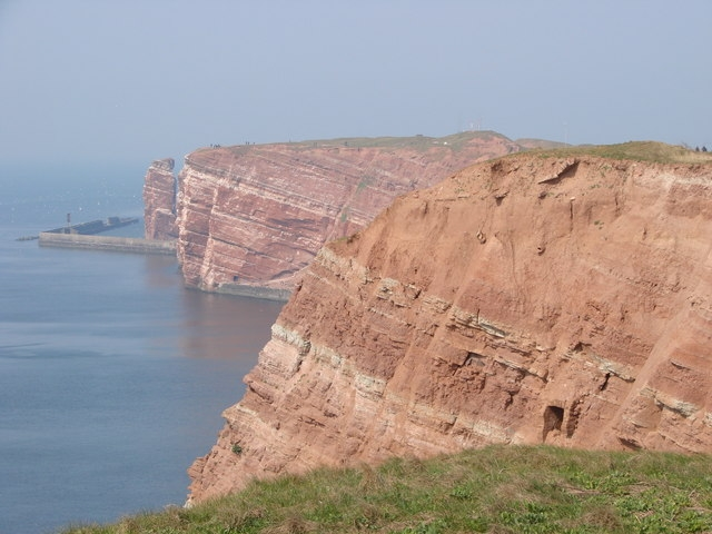 Towering red sandstone cliffs of the island of Helgoland.