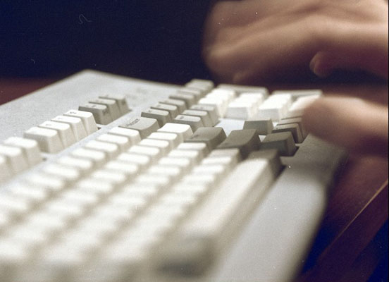 Hands typing.  Wellcome Images No. C0000486F08