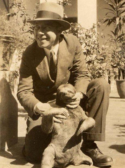 McKenzie with a sloth in Bolivia, 1930