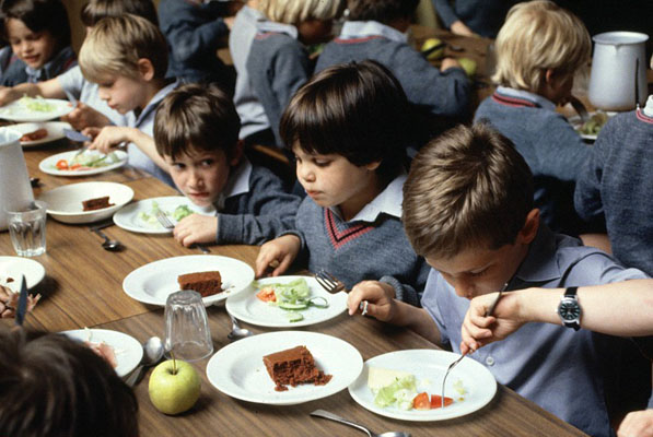 Primary school children, eating lunch. Wellcome Images No. AS0000149F06.