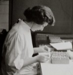 A woman studying blood samples