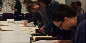 People viewing medieval manuscripts.
