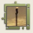 A flare stack is a tall structure located at refineries. It is used for burning-off waste oil or gas.