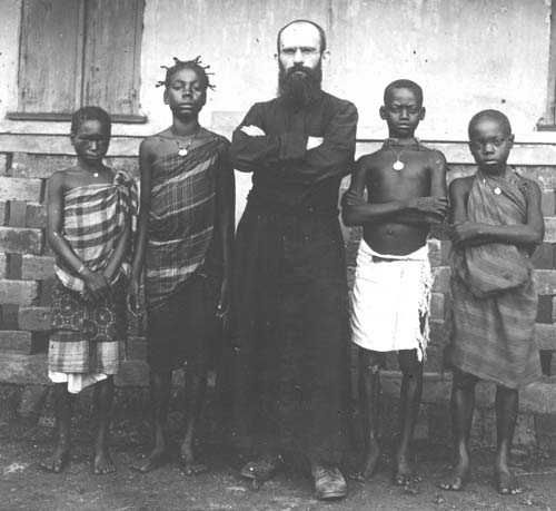 A missionary with natives