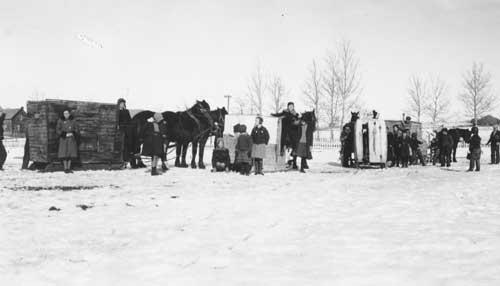 School children with horse drawn vehicles