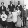 Pictured  is the family of Magnus Tipman circa 1916. Top row: Mary, John, and Mike. Lower row: Ferdie, Sophia (the mother), Edward, Sophie, Louise and Ado.